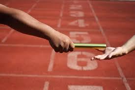 Relay race baton exchange | Premium Photo